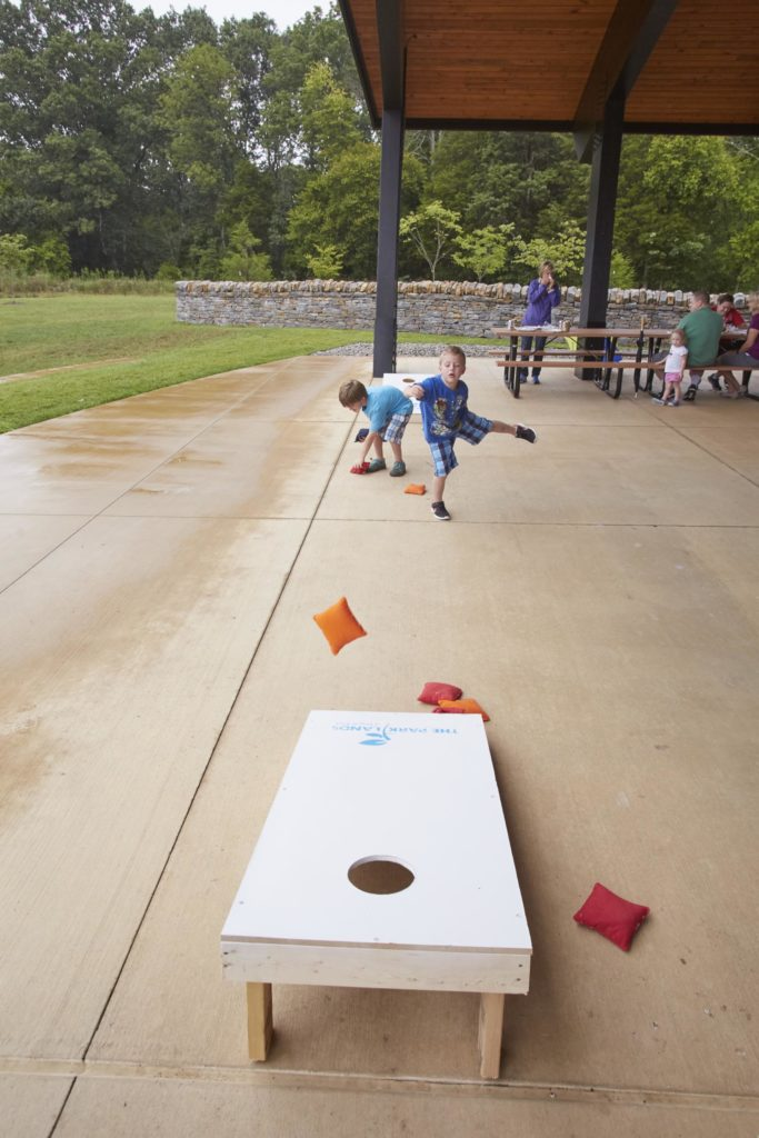 Two children playing cornhole