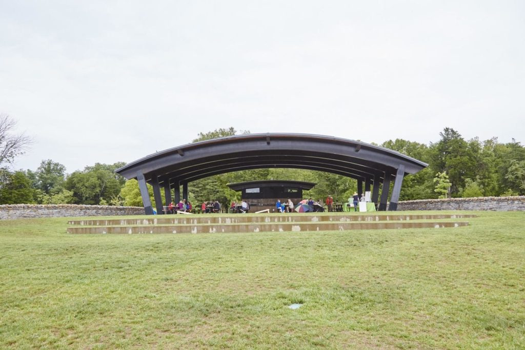 A group of people gather at an outdoor venue