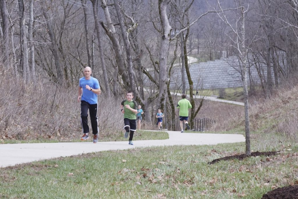 A man and boy jog