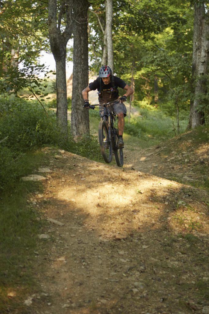 A man mountain bikes