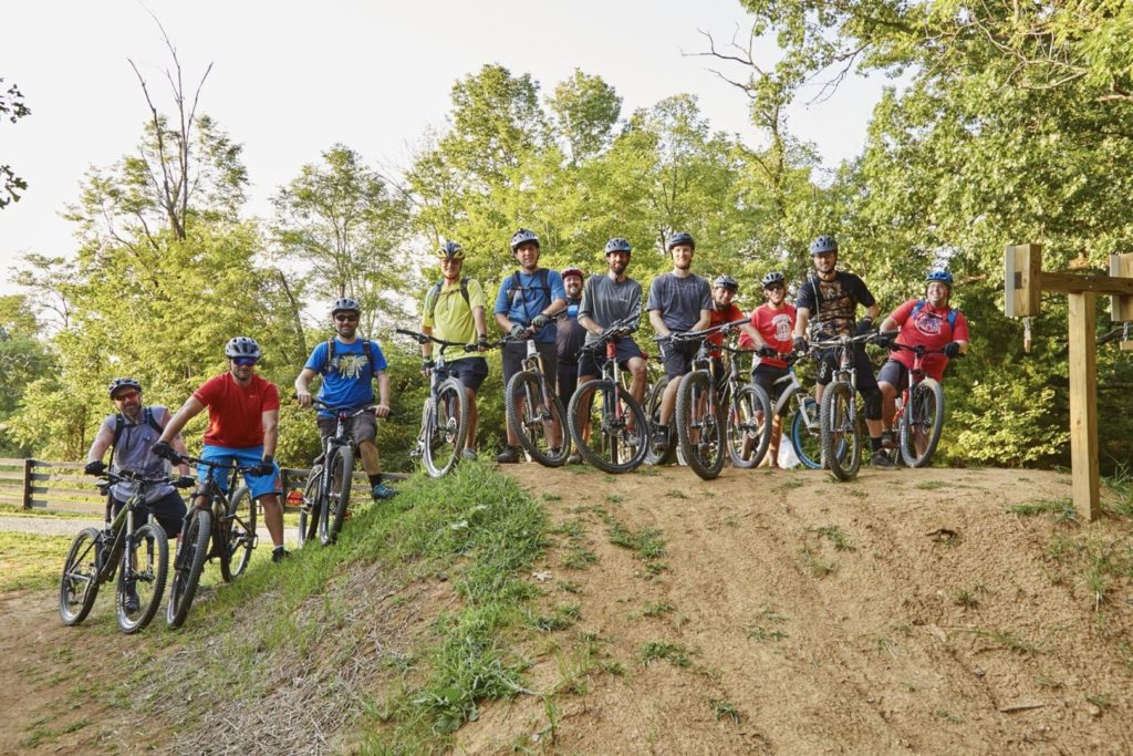 A group of mountain bikers pose for a picture