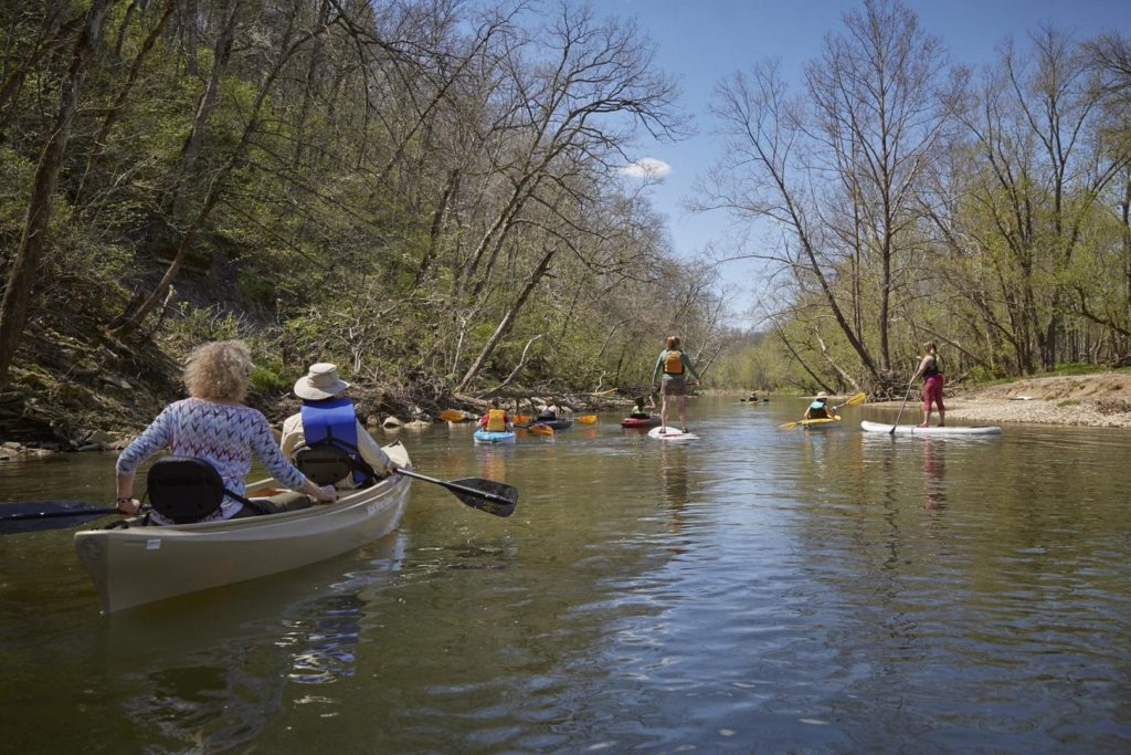 People pose during a kayak trip