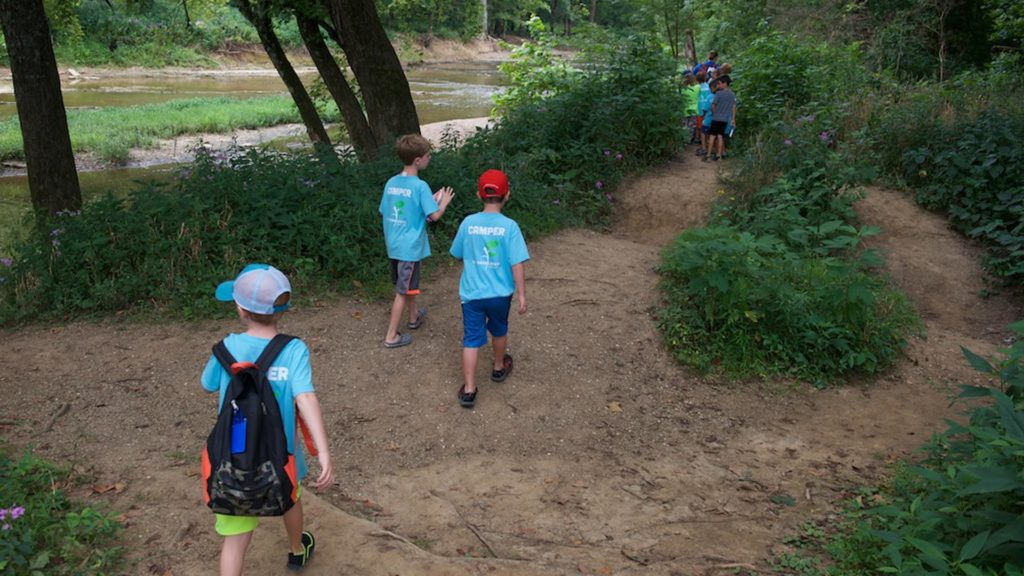 Children hike through a trail