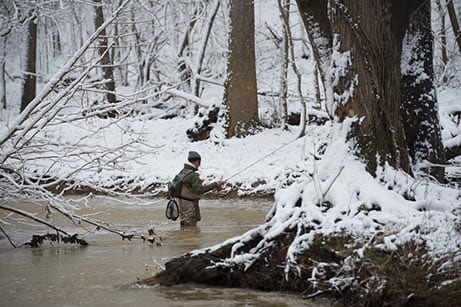 Man fishes in the snow