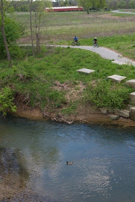 A walking path next to a river