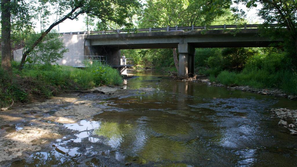 A river flows under a bridge